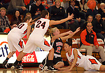 SIOUX FALLS, SD: DECEMBER 10: Kelsey Knecht #30, Hannah Nieman #24 and Sydney Koel #52 from Washington triple team Kylee Goodvin #21 from Sioux City Washington as she passes the ball from her knees in the first quarter of their season opener Tuesday night at Washington. (photo by Dave Eggen/Inertia)