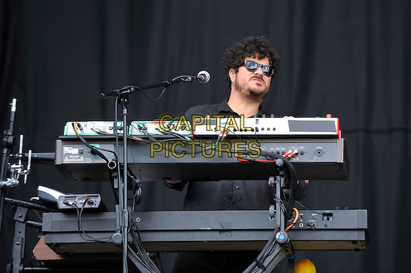 Richard Swift of The Shins.performing on Day 2 at Reading Festival, Reading, England. .25th August 2012.on stage in concert live gig performance performing music half length black shirt keyboards sunglasses shades    .CAP/MAR.© Martin Harris/Capital Pictures.