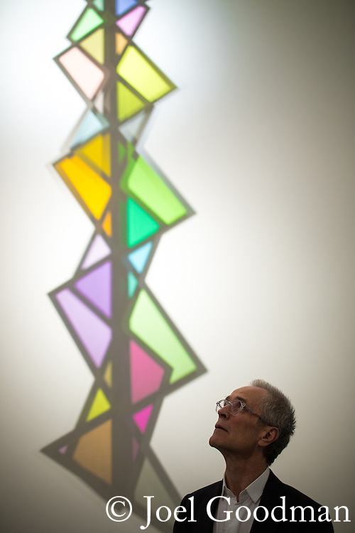 "© Joel Goodman - 07973 332324 . 13/02/2015 .  Manchester , UK . Artist DAVID BATCHELOR and the illuminated shadow of his sculpture "" Plato's Disco "" , which was specifically commissioned for the space . Opening of the newly refurbished Whitworth Gallery on Oxford Road in Manchester , following a £15 million refurbishment and expansion . Photo credit : Joel Goodman"