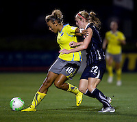 Becky Sauerbrunn (22)) of the Washington Freedom stays close to Lianne Sanderson (10) of the Philadelphia Independence during their game at the Maryland SoccerPlex in Boyds, Maryland.  The Washington Freedom defeated the Philadelphia Independence, 2-0.