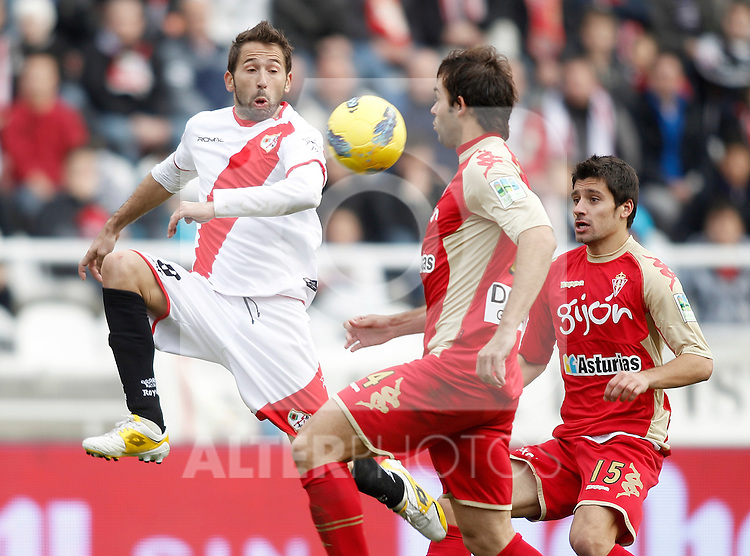 Sporting de Gijon's Roberto Canella against Rayo Vallecano's Raul Tamudo during La Liga Match. December 11, 2011. (ALTERPHOTOS/Alvaro Hernandez)