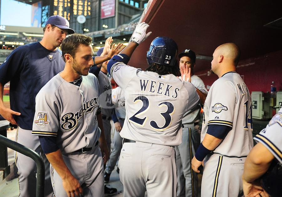 May 7, 2010; Phoenix, AZ, USA; Milwaukee Brewers second baseman (23) Rickie Weeks is congratulated after hitting a home run in the third inning against the Arizona Diamondbacks at Chase Field. Mandatory Credit: Mark J. Rebilas-