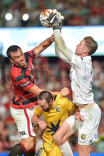 01.04.2016. Pirtek Stadium, Parramatta, Australia. Hyundai A-League. Western Sydney Wanderers versus Central Coast Mariners. Mariners goalkeeper Adam Pearce collects the ball under pressure from Wanderers forward Mark Bridge. The Wanderers won 4-1.