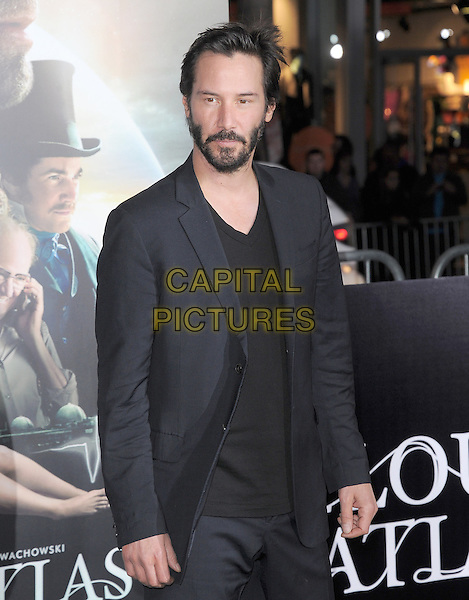 Keanu Reeves.The L.A. Premiere of 'Cloud Atlas' held at The Grauman's Chinese Theatre in Hollywood, California, USA..October 24th, 2012 .half length top suit jacket beard facial hair black   .CAP/RKE/DVS.©DVS/RockinExposures/Capital Pictures.