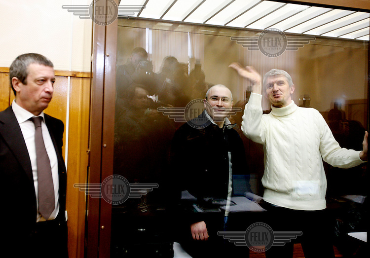 Fallen oligarch Mikhail Khodorokovsky (centre) and co-defendant Platon Lebedev (right) appear in court for the beginning of a second fraud trial. The former Yukos shareholders were first convicted in 2005 on charges that their supporters say are politically motivated.