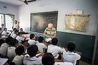 Father Laborde interact with the students in a class at Ekpranta Nagar School. West Bengal, India, Arindam Mukherjee/Agency Genesis