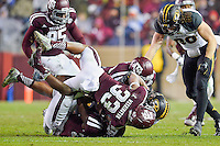 Missouri tailback Marcus Murphy (6) is brought down by linebacker Shaan Washington (33) during an NCAA football game, Saturday, November 15, 2014 in College Station, Tex. Missouri defeated Texas A&M 34-27. (Mo Khursheed/TFV Media via AP Images)
