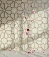 Jardin, a handmade mosaic shown in honed Bianco Antico, polished Calacatta and Raw Fiber glass. Designed by Sara Baldwin for New Ravenna.<br />