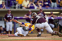 LSU Tigers first baseman Chris Chinea (26) slides home attempt to avoid the tag of Texas A&M catcher Michael Barash (5) during the Southeastern Conference baseball game on April 25, 2015 at Alex Box Stadium in Baton Rouge, Louisiana. Texas A&M defeated LSU 6-2. (Andrew Woolley/Four Seam Images)