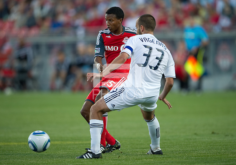 Toronto FC defender Danleigh Borman#25 and Vancouver Whitecaps FC midfielder Peter Vagenas # 33 in action during an MLS game between the Vancouver Whitecaps and the Toronto FC at BMO Field in Toronto on June 29, 2011..