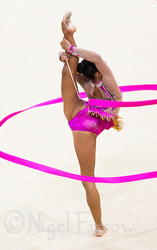 11 AUG 2012 - LONDON, GBR - Daria Dmitrieva (RUS) of Russia performs her ribbon routine during the 2012 London Olympic Games Individual All-Around Rhythmic Gymnastics final at Wembley Arena in London, Great Britain (PHOTO (C) 2012 NIGEL FARROW)