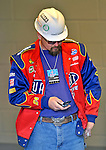 29 March 2008: A Washington Nationals construction worker checks a message on his cell phone prior to an exhibition game against the Baltimore Orioles at Nationals Park, in Washington, DC. The matchup is the first professional game to be played in the new ballpark, prior to the upcoming official opening day inaugural game. ..Mandatory Photo Credit: Ed Wolfstein Photo