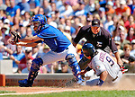 2 July 2005: Michael Barrett, catcher for the Chicago Cubs, makes a late stop at the plate, while Vinny Castilla slides home safely during a game against the Washington Nationals. The Nationals defeated the Cubs 4-2 in front of 40,488 at Wrigley Field in Chicago, IL. Mandatory Photo Credit: Ed Wolfstein