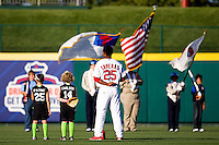Oscar Taveras (25) of the Springfield Cardinals stands with young ball players as the color guard displays the colors during a game against the Northwest Arkansas Naturals at Hammons Field on June 14, 2012 in Springfield, Missouri. (David Welker/Four Seam Images).