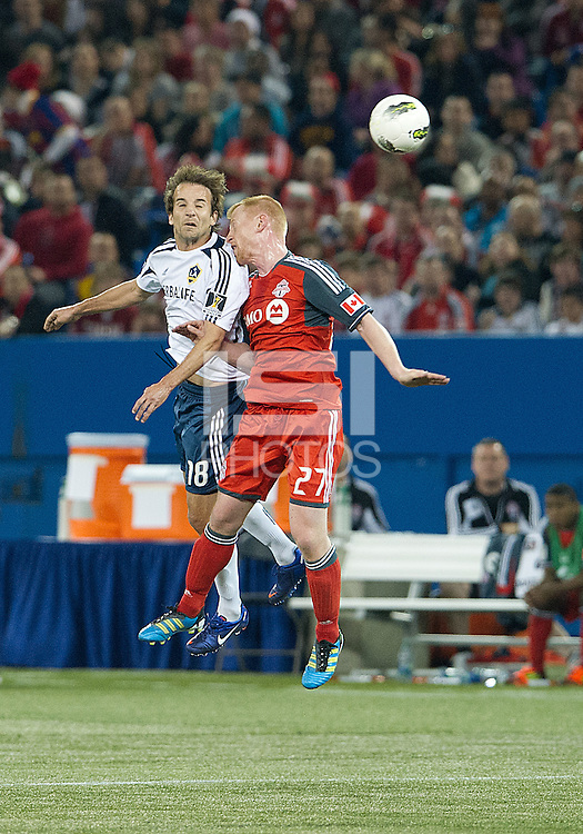 07 March 2012: LA Galaxy forward Mike Magee #18 and Toronto FC defender Richard Eckersley #27 in action during a CONCACAF Champions League game between the LA Galaxy and Toronto FC at the Rogers Centre in Toronto..The game ended in a 2-2 draw.