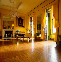 Curtains, pelmets and walls of yellow silk infuse the first floor drawing room of the Sir John Museum in London's Lincoln's Inn fields with a sunny golden glow