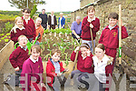 GARDEN FUN: Fr Pat Moore (PP), right, with locals enjoying the new community garden at the rear of Duagh church, with clockwise from right, Rowanna McNulty, Daniel McAuliffe, Orla Greaney, Leona O'Regan, TJ Cosgrove, Kylie Walsh, Dale O'Carroll, Aoife Hartnett, Majella Lucey, Paul Cosgrove, Paddy Keane (School Principal), Sr Kathleen, Nora Gaire.
