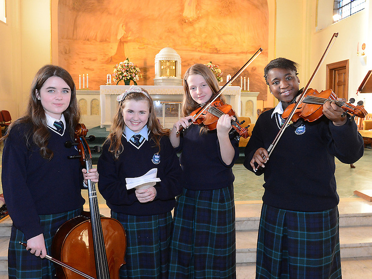 Ciara Duffy, Orla Mallon, Rachel Ní Fhearaigh and Endurance Kalabor at the Mass of Thanksgiving at Our Lady of Lourdes Church celebrating 200 years in education of the Presentation Community in Drogheda. Photo:Colin Bell/pressphotos.ie