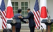 Japan's Prime Minister Shinzo Abe and US President Barack Obama shake hands and depart after holding a joint press conference at The White House in Washington DC for a State Visit, April 28, 2015. Credit: Chris Kleponis / CNP