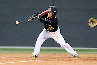 Second baseman Alec Paradowski (15) of the Wofford College Terriers bats in a game against the Boston College Eagles on Friday, February 13, 2015, at Russell C. King Field in Spartanburg, South Carolina. Wofford won, 8-4. (Tom Priddy/Four Seam Images)