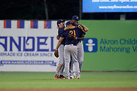 State College Spikes outfielder David Vinsky (left), Stanley Espinal (21), and Terry Fuller (right) celebrate closing out a NY-Penn League game against the Mahoning Valley Scrappers on August 29, 2019 at Eastwood Field in Niles, Ohio.  State College defeated Mahoning Valley 8-1.  (Mike Janes/Four Seam Images)