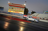 Jan 25, 2009; Chandler, AZ, USA; NHRA funny car driver Mike Neff does a burnout during testing at the National Time Trials at Firebird International Raceway. Mandatory Credit: Mark J. Rebilas-