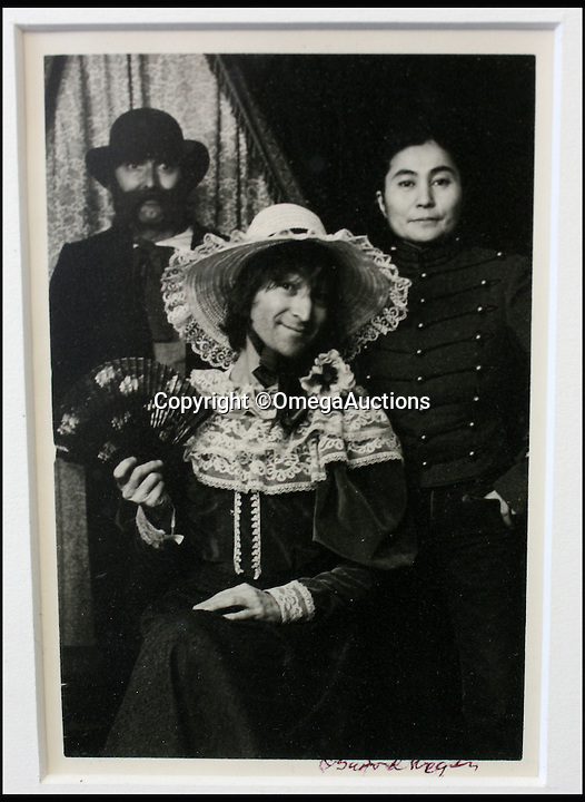 BNPS.co.uk (01202 558833)<br /> Pic: OmegaAuctions/BNPS<br /> <br /> Jonh Lennon with his wife Yoko Ono and a friend.<br /> <br /> A remarkable set of family photos that show John Lennon larking around and dressing as a woman have emerged for sale.<br /> <br /> The five original black and white pictures offer a rare insight into the personal life of the mega star and show Lennon, his wife Yoko Ono and baby son Sean having fun in costume while on holiday in America. <br /> <br /> They were taken in a vintage clothing photography studio in Stockbridge, Massachusetts in 1977 - just three years before the music icon was shot outside his New York apartment - and also feature Sean's nanny and a friend.