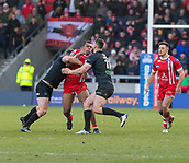 10th February 2019, AJ Bell Stadium, Salford, England; Betfred Super League rugby, Salford Red Devils versus London Broncos; Ben Nakubuwai of Salford Red Devils is tackled by Matty Gee and Will Lovell of London Broncos