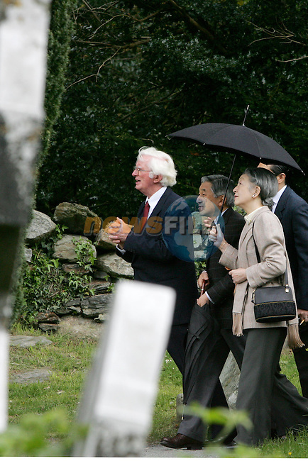 COUNTY WICKLOW, IRELAND - MAY 8: Emperor Akihito, the 125th Emperor of Japan, listens to Dr Peter Harbison about the monastic remains and Her Imperial Majesty Michoko, Empress of Japan, as they stroll during a visit to the Glendalough National Park, May 8, 2005, in County Wicklow, Ireland. The royal couple are on a three-day visit to Ireland..Photo AFP/NEWSFILE/FRAN CAFFREY..(Photo credit should read AFP Photo FRAN CAFFREY/NEWSFILE)...This Picture has been sent you under the condtions enclosed by:.Newsfile Ltd..the Studio,.Millmount Abbey,.Drogheda,.Co Meath..Ireland..Tel: +353(0)41-9871240.Fax: +353(0)41-9871260.GSM: +353(0)86-2500958.email: pictures@newsfile.ie.www.newsfile.ie.FTP: 193.120.102.198..This picture is from Fran Caffrey@newsfile.ie