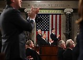 US President Donald J. Trump and the entire chamber reacts towards Carryn Owens, widow of Navy Seal Ryan Owens, as Trump delivers his first address to a joint session of Congress from the floor of the House of Representatives in Washington, DC, USA, 28 February 2017.  Traditionally the first address to a joint session of Congress by a newly-elected president is not referred to as a State of the Union.<br /> Credit: Jim LoScalzo / Pool via CNP
