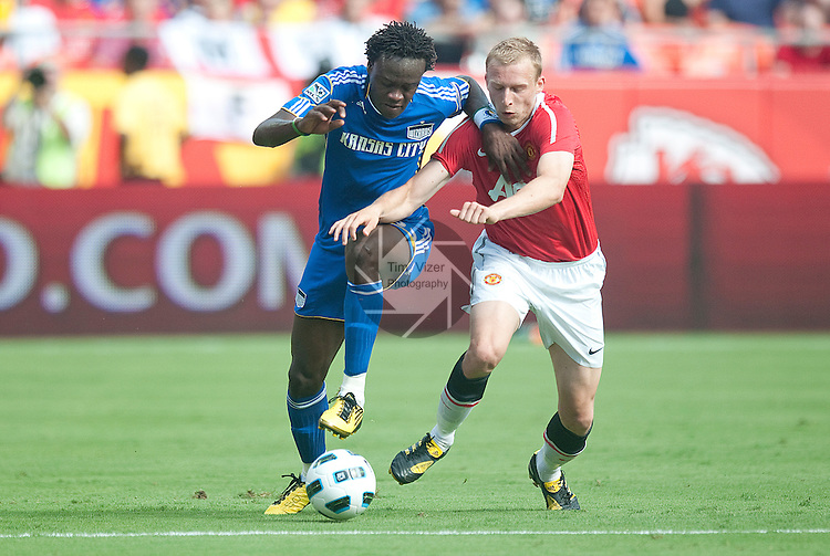 """July 25, 2010          Kansas City Wizards forward Kei Kamara (23, left) battles Manchester United defender Ritchie De Laet (30, right) for the ball in the first half.  The Kansas City Wizards of Major League Soccer hosted England's Manchester United of the English Premier League in an international friendly game on Sunday July 25, 2010 at Arrowhead Stadium in Kansas City, Missouri.  The game is the third of four stops for Manchester United on their """"Tour 2010"""", which is four games in North America."""