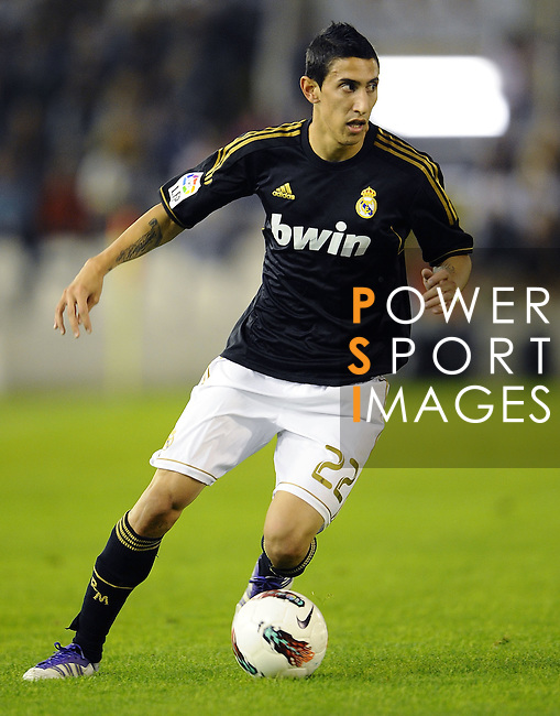 SANTANDER - SEPTEMBER 21:  Angel Fabian Di Maria of Real Madrid runs with the ball during the La Liga soccer match between Real Racing Club and Real Madrid at El Sardinero Stadium on September 21, 2011 in Santander, Spain. Photo by Victor Fraile / The Power of Sport Images