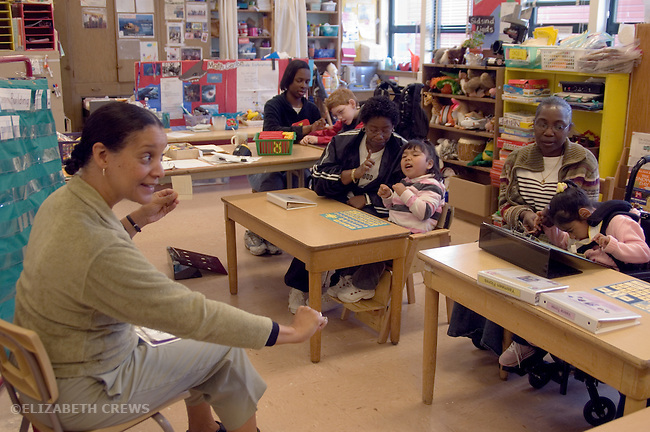 Oakland CA Special education teaching developmentally disabled children, with their aides, in primary school special education classroom MR