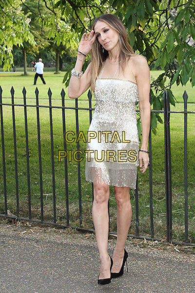 Sarah Jessica Parker<br /> Attending the Serpentine Gallery Summer Party at the Serpentine Gallery, London, England, UK, June 26th 2013.<br /> full length hand touching hair  beige nude mesh silver gold tassels flapper dress shiny sparkly fringed black shoes <br /> CAP/ROS<br /> &copy;Steve Ross/Capital Pictures