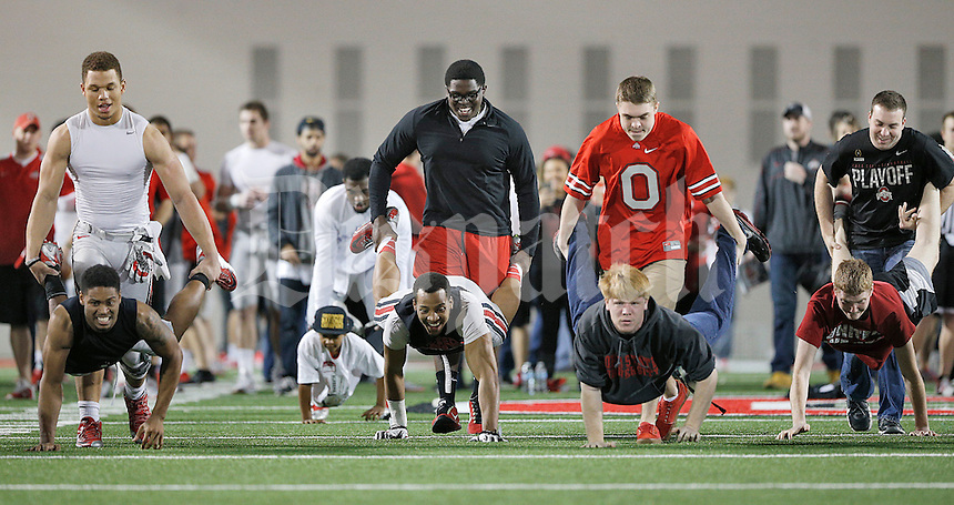 Ohio State University football players and students run a wheelbarrow race inside the Woody Hayes Athletic Center on April 11, 2015. Students were invited to the facility for the fourth annual Student Appreciation Practice .  (Chris Russell/Dispatch Photo)