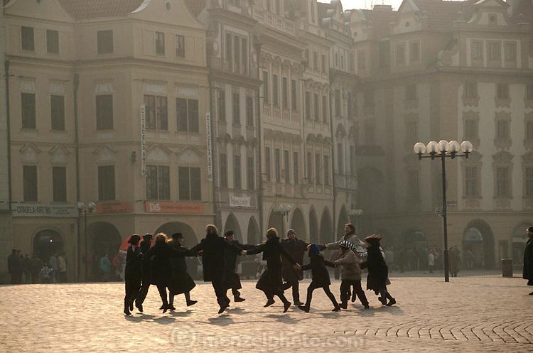 CZE_33_xs.Spontanous dancing right after the Velvet Revolution. Prague, Czech Republic. Starometske Namesti (old town square). .