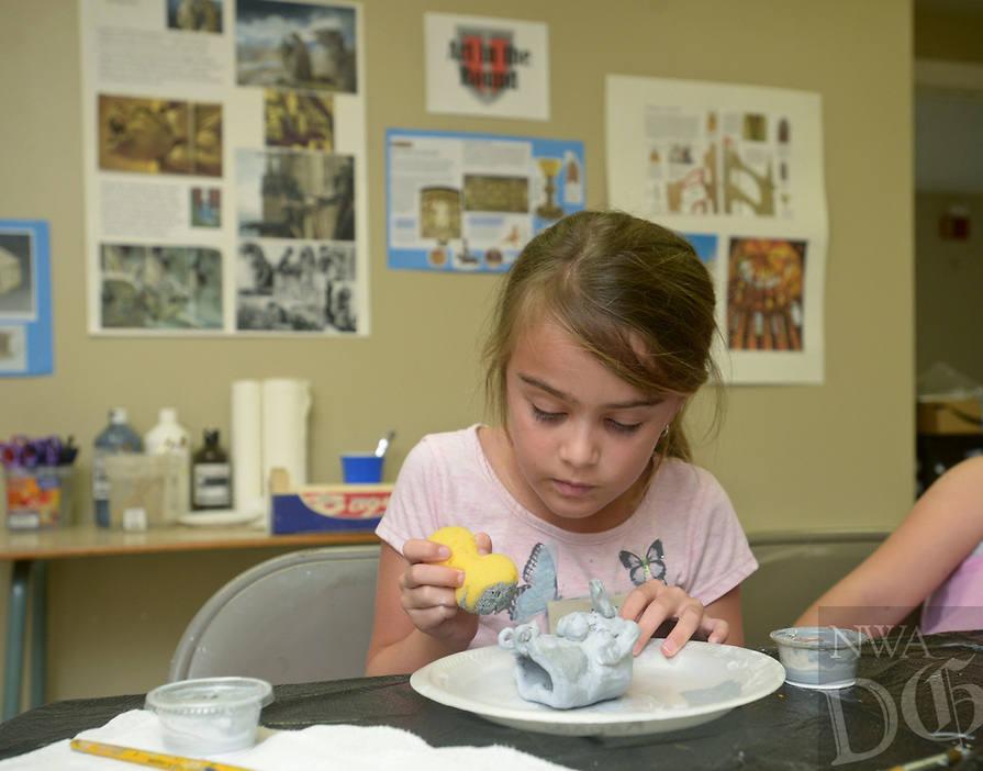 NWA Democrat-Gazette/BEN GOFF @NWABENGOFF<br /> Katrina Coello, 7, of Rogers finishes making a gargoyle out of modeling clay Friday, July 14, 2017, during ArtCamp: Medieval Adventure at First Presbyterian Church in Rogers. During the five-day camp for rising 1st through 7th graders, students made various art projects inspired by such things as illuminated manuscripts, stained glass windows, relief carving, tapestries and architecture.