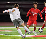 CBC midfielder Cade Walsh (left) clears the ball as Kirkwood Jake Hinrichs closes in. CBC played Kirkwood in a Class 4 sectional soccer game at Kirkwood High School in Kirkwood on Thursday November 14, 2019.<br /> Tim Vizer/Special to STLhighschoolsports.com