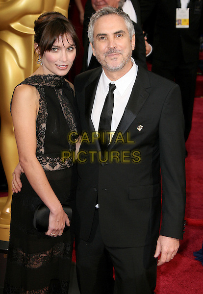 02 March 2014 - Hollywood, California - Alfonso Cuaron, Sheherazade Goldsmith. 86th Annual Academy Awards held at the Dolby Theatre at Hollywood &amp; Highland Center. <br /> CAP/ADM<br /> &copy;AdMedia/Capital Pictures