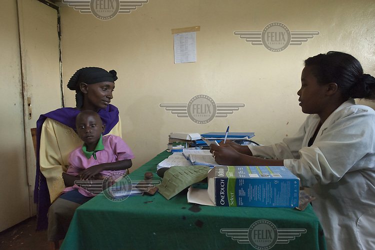 A woman with her daughter during a consultation with a doctor.