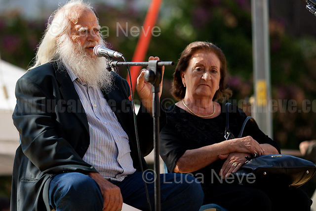 """""""I cannot die without Justice"""" - Vincenzo Agostino & Augusta Schiera - Parents of Nino Agostino, Police officer killed by Cosa nostra mafia in 1989 along with his pregnant wife Ida Castelluccio.<br /> <br /> Palermo (Sicily - Italy), 19/07/2017. """"Basta depistaggi e omertà di Stato!"""" (""""Stop disinformation & omertá by the State!"""")(1). Public event to commemorate the 25th Anniversary of the assassination of the anti-mafia Magistrate Paolo Borsellino along with five of his police """"scorta"""" (Escorts from the special branch of the Italian police force who protect Judges): Agostino Catalano, Emanuela Loi (The first Italian female member of the police special branch and the first woman of this branch to be killed on duty), Vincenzo Li Muli, Walter Eddie Cosina and Claudio Traina. The event was held at Via D'Amelio, the road where Borsellino was killed. Family members of mafia victims, amongst others, made speeches about their dramatic experiences, mafia violence and unpunished crimes, State cover-ups, silence ('omertá'), and misinformation. Speakers included, amongst others, Vincenzo Agostino & Augusta Schiera, Salvatore & Cristina Catalano, Graziella Accetta, Massimo Sole, Paola Caccia, Luciano Traina, Angela Manca, Stefano Mormile, Ferdinando Imposimato, Judge Nino Di Matteo. The event ended with the screening of the RAI docu-fiction, 'Adesso Tocca A Me' ('Now it's My Turn' - Watch it here: http://bit.ly/2w3WJUX ).<br /> <br /> For more info & a video of the event please click here: http://bit.ly/2eQfNT3 & http://bit.ly/2eQbmrj & http://19luglio1992.com & http://bit.ly/2he8hCj<br /> <br /> (1) 'Omerta' is the term used in Italy to refer to the code of silence used by mafia organisations, as well as the culture of silence that is entrenched in society at large (especially among victims of mafia crimes, as they fear recriminations), about the existence of organised crime and its activities."""