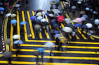 Pedestrians cross Des Voeux Road under heavy rain in Central, Hong Kong.<br /> 17 Jun 2008
