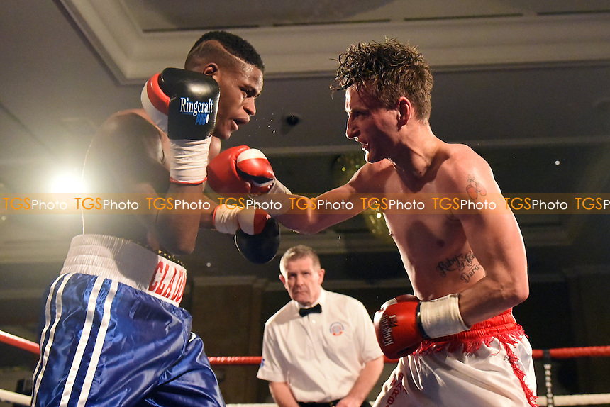 Rhys Saunders (white/red shorts) defeats Claudio Paulo during a Boxing Show at the Hilton Hotel, Mayfair, England on 11/12/2015