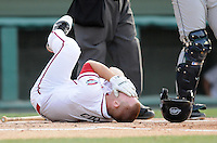 Second baseman Sean Coyle (5) of the Greenville Drive lies on the ground after being hit in the face by a pitch in a game against the Lexington Legends on June 6, 2011, at Fluor Field at the West End in Greenville, S.C. Coyle left the game, had oral surgery June 8 and was put on the disabled list June 9. Photo by Tom Priddy / Four Seam Images