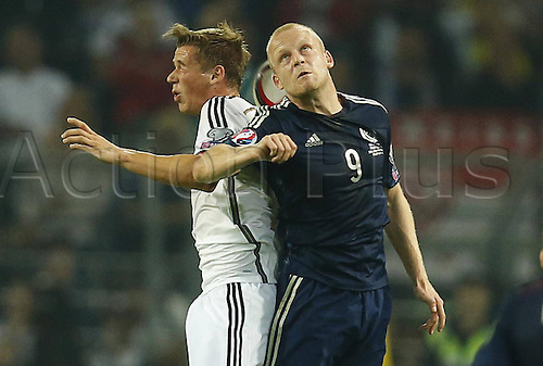 07.09.2014. Dortmund, Germany.   international match Germany Scotland  in Signal Iduna Park in Dortmund. Eric  Durn in a heading duel with Steven Naismith SCO