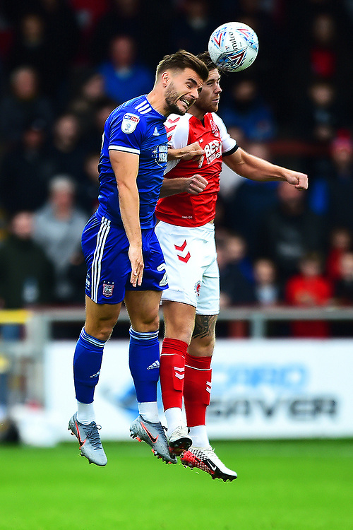 Ipswich Town's Luke Garbutt competes in the air with Fleetwood Town's Wes Burns<br /> <br /> Photographer Richard Martin-Roberts/CameraSport<br /> <br /> The EFL Sky Bet League One - Fleetwood Town v Ipswich Town - Saturday 5th October 2019 - Highbury Stadium - Fleetwood<br /> <br /> World Copyright © 2019 CameraSport. All rights reserved. 43 Linden Ave. Countesthorpe. Leicester. England. LE8 5PG - Tel: +44 (0) 116 277 4147 - admin@camerasport.com - www.camerasport.com