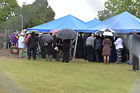 """5/30/15 Indianola   Family members gather at the graveside for the burial of B B King. """"See That My Grave Is Kept Clean"""" one of BB Kings famous songs forecast his funeral procession complete with two white horses and a black horse flanked with two signed Gibson guitars. Fans lined the street to see B.B. Kings final homecoming and pay their respect. Photo ©Suzi Altman"""