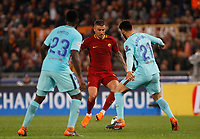 Roma s Aleksandar Kolarov, left is challenged by FC Barcelona Samuel Umtiti, left, and Andre Gomes, during the Uefa Champions League quarter final second leg football match between AS Roma and FC Barcelona at Rome's Olympic stadium, April 10, 2018.<br /> UPDATE IMAGES PRESS/Riccardo De Luca