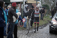 Dwars Door Vlaanderen 2013. Giacomo Nizzolo (ITA/Leopard-Trek) with a mechanical up the Oude Kwaremont