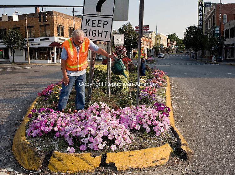 TORRINGTON--18 July 08--071808TJ16 - John Hogan, of Torrington, a member of the Beautification Committee, waters flowers in a median on Main Street in Torrington on Friday, July 18, 2008. (T.J. Kirkpatrick/Republican-American)